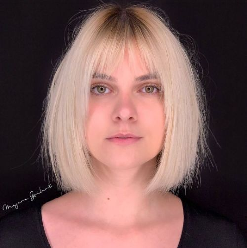 Frizzy Blonde Bob with Bangs