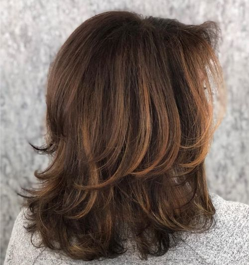 Hairstyle with Medium Layers and Bangs