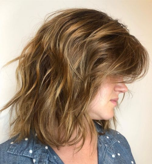 Voluminous Hairstyle with Layered Bangs