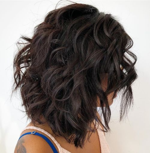 Voluminous Medium-Length Layered Hairstyle for Curly Hair